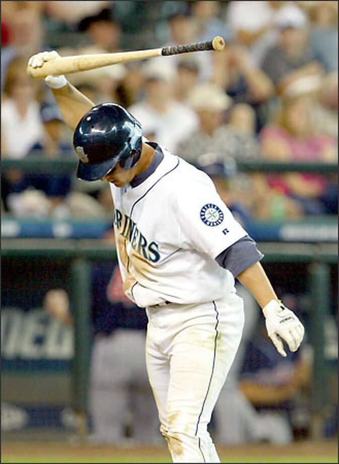 Bret Boone slams his bat after striking out against Jay Witasick to end the game. Boone went 0-for-5, stranding five baserunners. Photo: David Bitton/Seattle Post-Intelligencer
