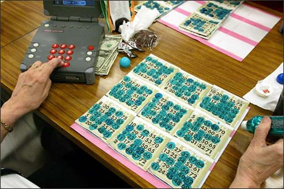 The eyes and hands of a serious bingo player are always in motion. Photo: David Bitton/Seattle Post-Intelligencer