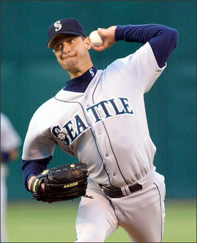 Mariners starting pitcher Jamie Moyer allowed four hits and one run in 7 1/3 innings last night to earn his 11th win of the season. Photo: GEORGE NIKITIN/AP