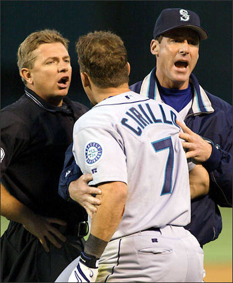 Manager Bob Melvin fails to prevent Jeff Cirillo from being ejected by home plate umpire Greg Gibson. Photo: GEORGE NIKITIN/AP