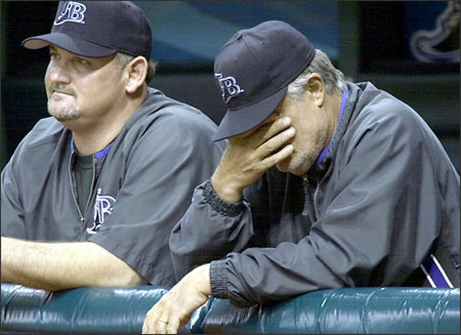 Lou Piniella, right, says his appetite isn't what it used to be. The hunger remains for winning, but not for food. Photo: CHRIS O'MEARA/P-I