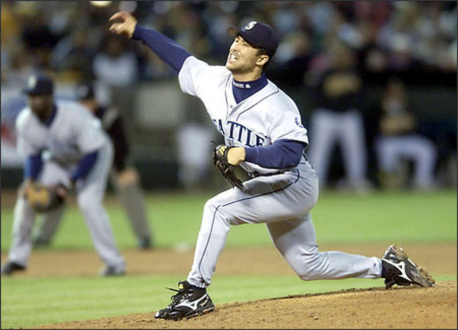 Mariners reliever Shigetoshi Hasegawa delivers a pitch during the ninth inning. Hasegawa allowed a hit and a walk in two innings. Photo: JULIE JACOBSON/AP