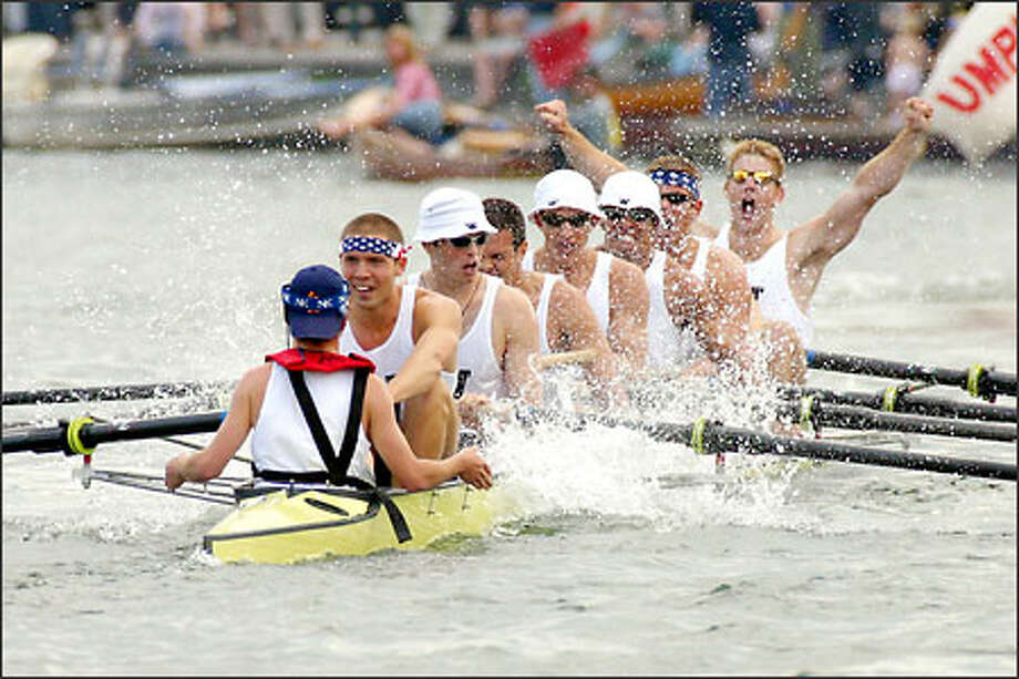 Members of the UW varsity eight celebrate their 4 3/4-length victory against Rutgers in the final in Henley-on-Thames, England. Photo: / Associated Press