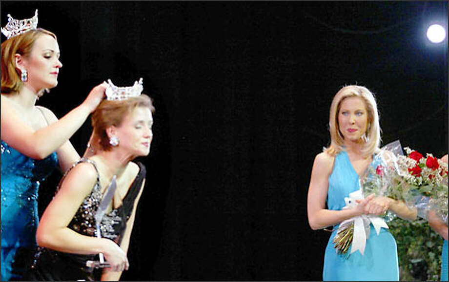 Amy Crawford, watches the 2002 Miss Washington, Amanda Beers, crown the 2003 Miss Washington, Fianna Dickson, at the Pantages Theater on Saturday. The pageant, a preliminary for the Miss America contest, was Crawford's last. Photo: Scott Eklund/Seattle Post-Intelligencer