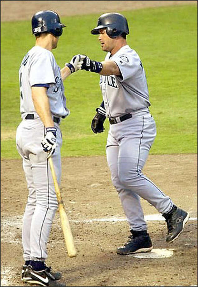 Edgar Martinez, right, punctuated selection to his seventh All-Star Game with a home run in the Mariners' 5-1 loss yesterday at Texas. Photo: TONY GUTIERREZ/AP