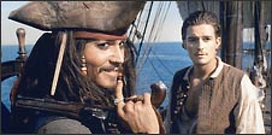 Capt. Jack Sparrow (Johnny Depp, left) and Will Turner (Orlando Bloom) join forces to rescue the governor's daughter and Sparrow's ship.