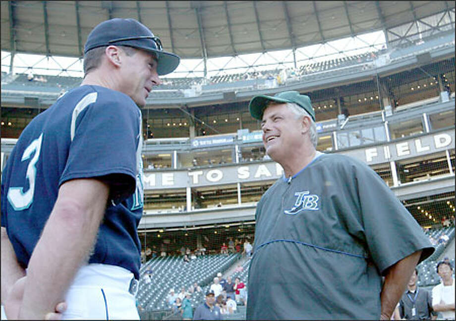 Seattle's Bob Melvin, left, and Tampa Bay's Lou Piniella get together to chat before the game last night at Safeco Field. They were hired for different reasons in contrasting situations. Photo: Scott Eklund/Seattle Post-Intelligencer