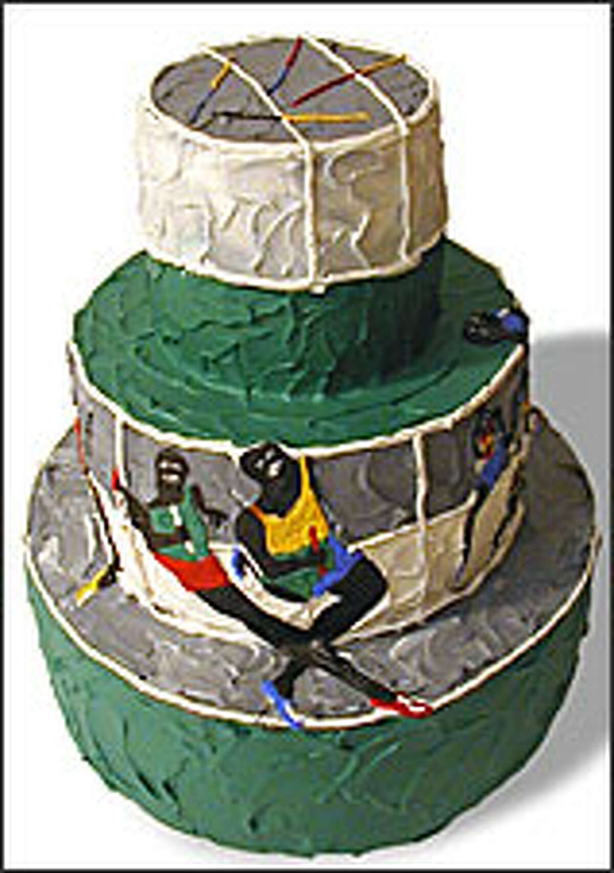 A plaster cake, honoring a painting by Jacob Lawrence, is one of 71 painted replicas celebrating the Seattle Art Museum's 70th birthday.