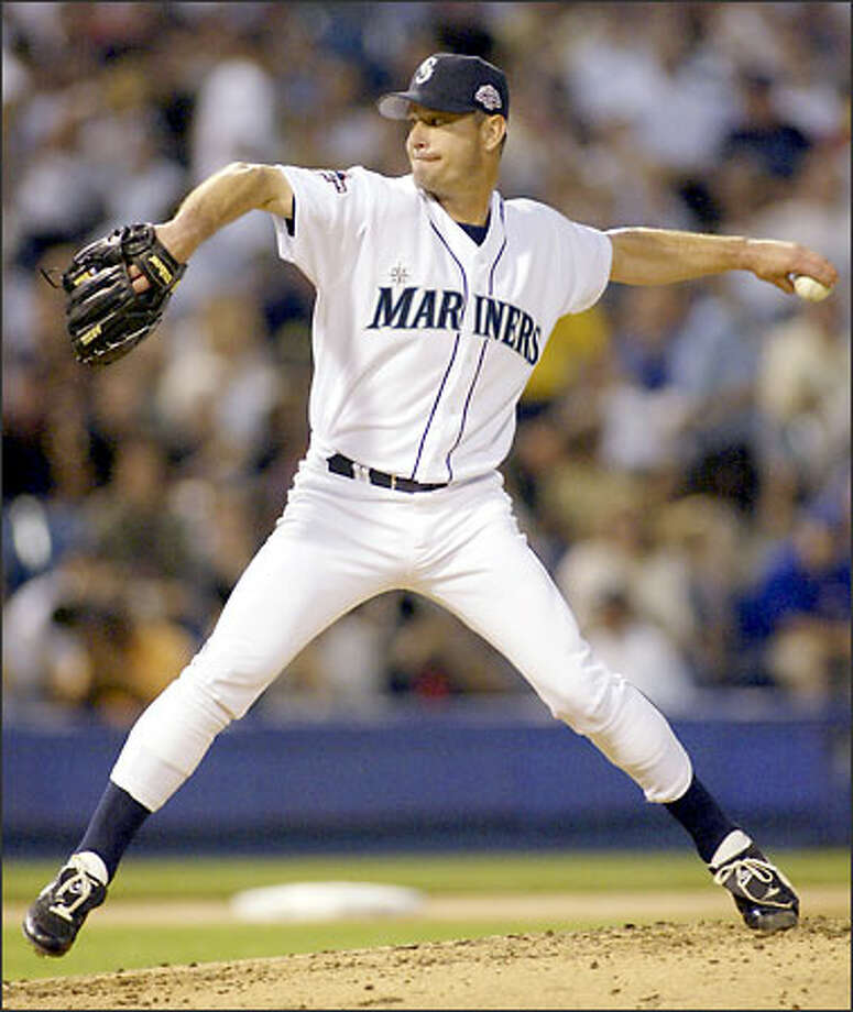 Jamie Moyer delivers a pitch during the fourth inning of the All-Star Game. Moyer struck out Jim Edmonds and got Albert Pujols and Barry Bonds to fly out during his inning of work. Photo: TED S. WARREN/AP