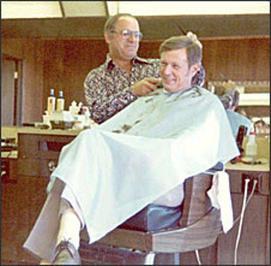 """Louie LaTorre trims an unidentified customer's hair in this 1974 photo. """"He could entertain anyone,"""" a friend says. Photo: LaTorre Family Photo"""