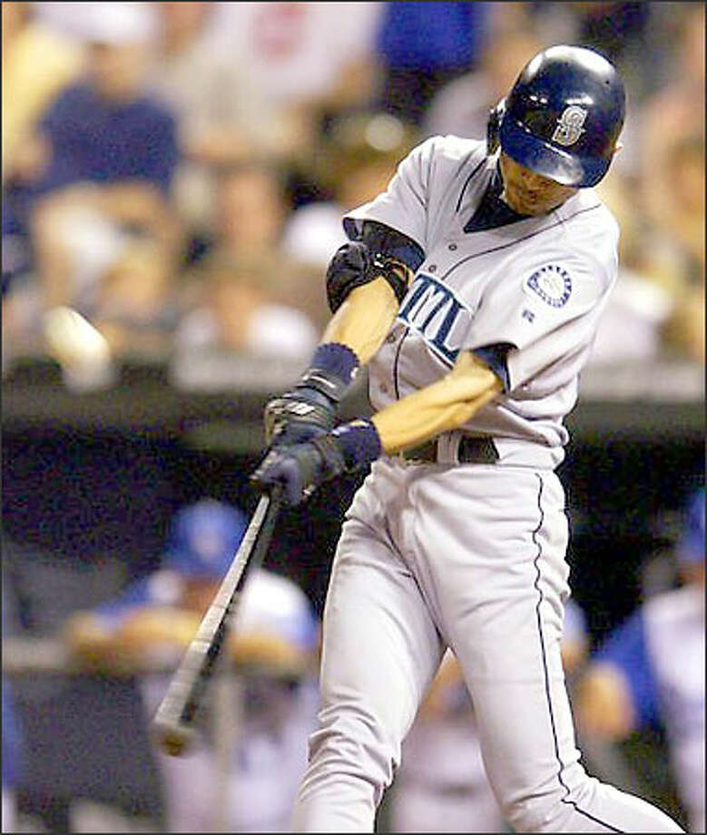 Ichiro Suzuki connects against Royals closer Mike MacDougal with two outs in the ninth inning for his first career grand slam. Photo: / Associated Press