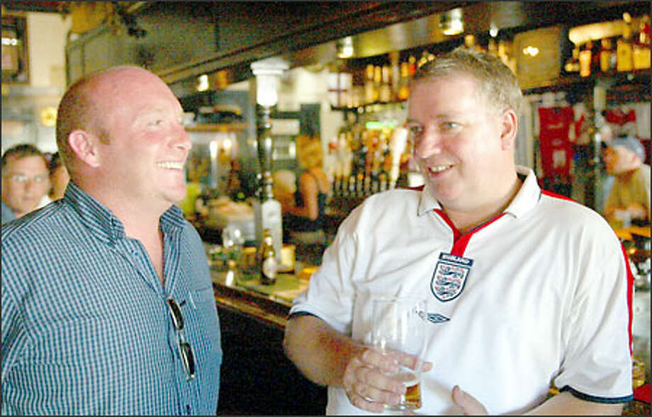 Fans Simon Stones, left, and Nigel Devine enjoy beers in anticipation of tomorrow's match. Photo: David Bitton/Seattle Post-Intelligencer