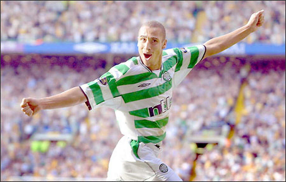 Swedish striker Henrik Larsson, in Celtic's traditional green-and-white uniform, leads the attack for one of Europe's most storied clubs. Photo: / Associated Press