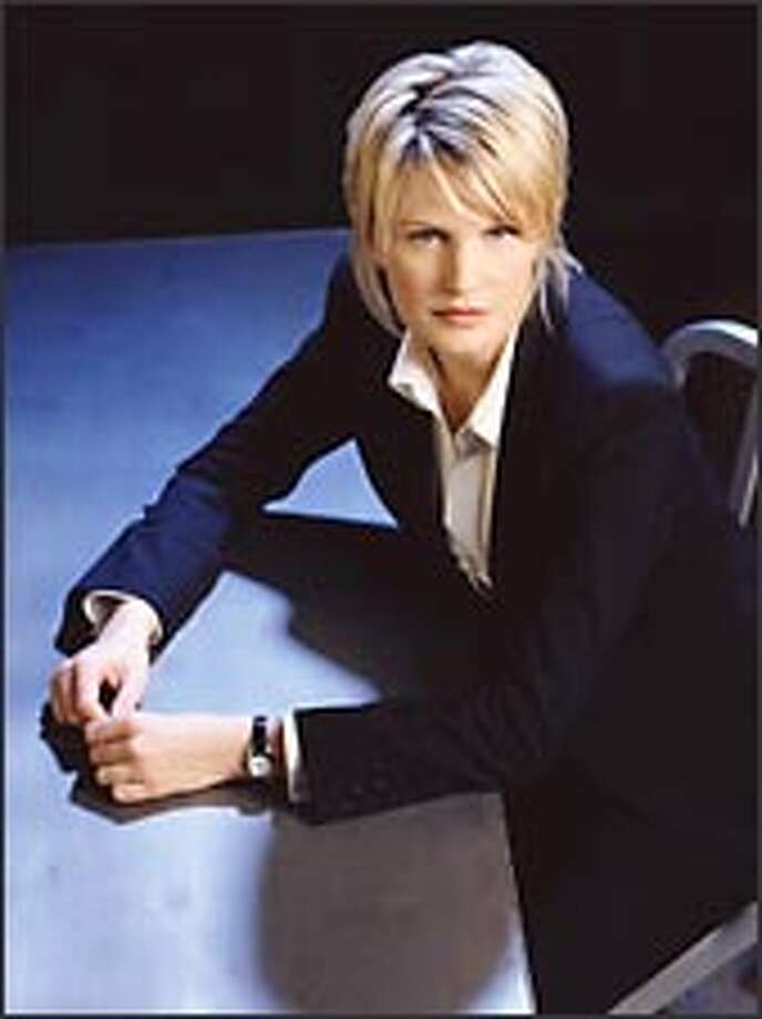 """In CBS's """"Cold Case,"""" Kathryn Morris stars as a detective in Philadelphia assigned to unravel challenging crimes. Photo: CBS / ©2003 CBS WORLDWIDE INC. ALL RIGHTS RESERVED."""