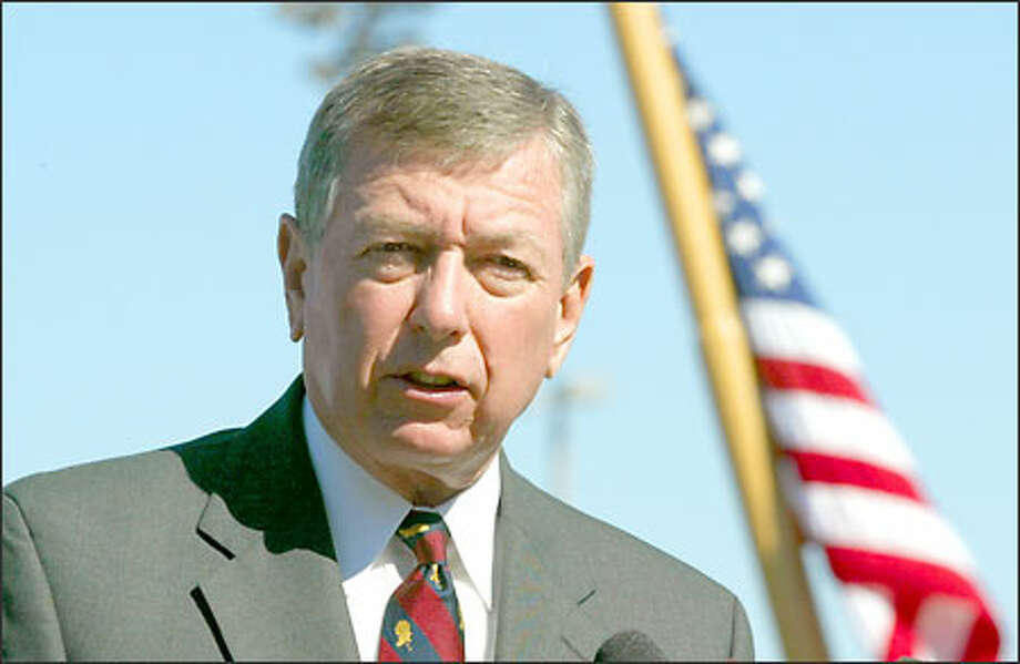 United States Attorney General John Ashcroft speaks to the media during Tuesdays press-conference at U.S.Coast Guard Integrated Support Command station in Seattle, Washington. Photo: Gilbert W. Arias/Seattle Post-Intelligencer