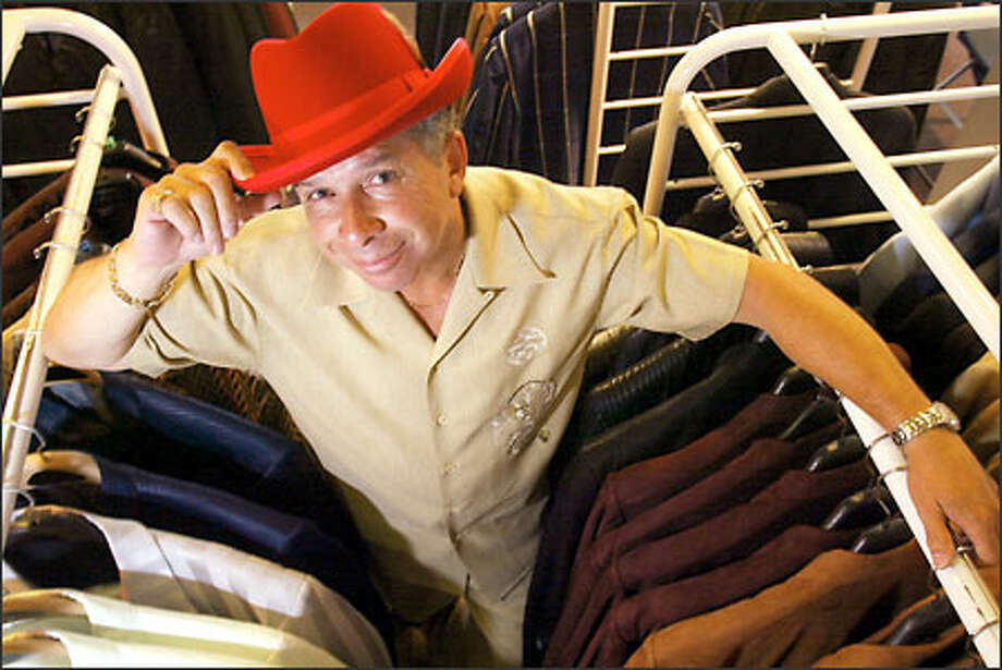 Leroy Shumate's store, Leroy Menswear on Pike Street, has modified its clientele over time. Now musicians and promgoers buy his colorful duds. Photo: Mike Urban/Seattle Post-Intelligencer