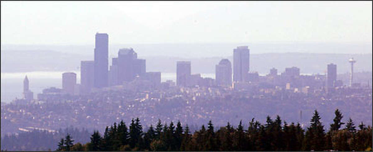 This is how Seattle's hazy skyline looked yesterday to people in Newcastle, south of Bellevue.