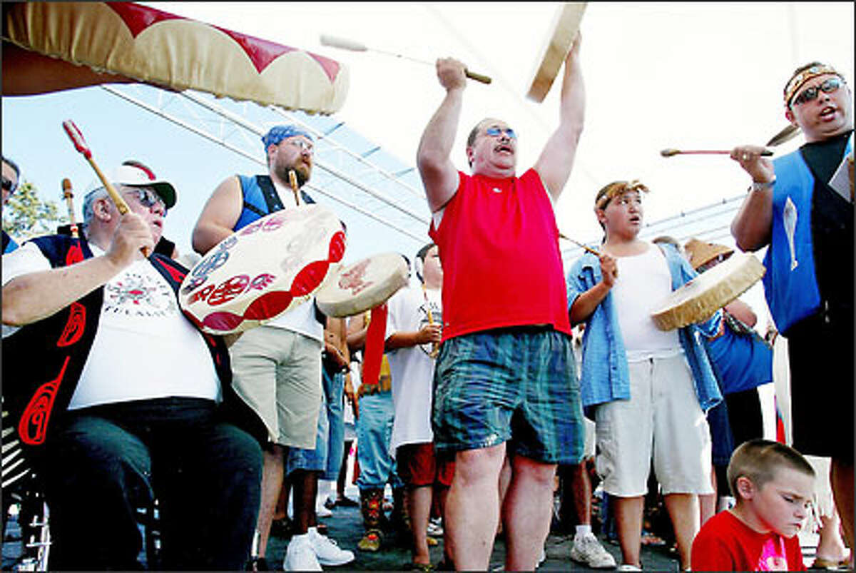 The Tulalip Canoe Family sings welcoming songs for the some 40 to 60 tribal canoes that arrive in Tulalip at the end of Canoe Journey 2003.