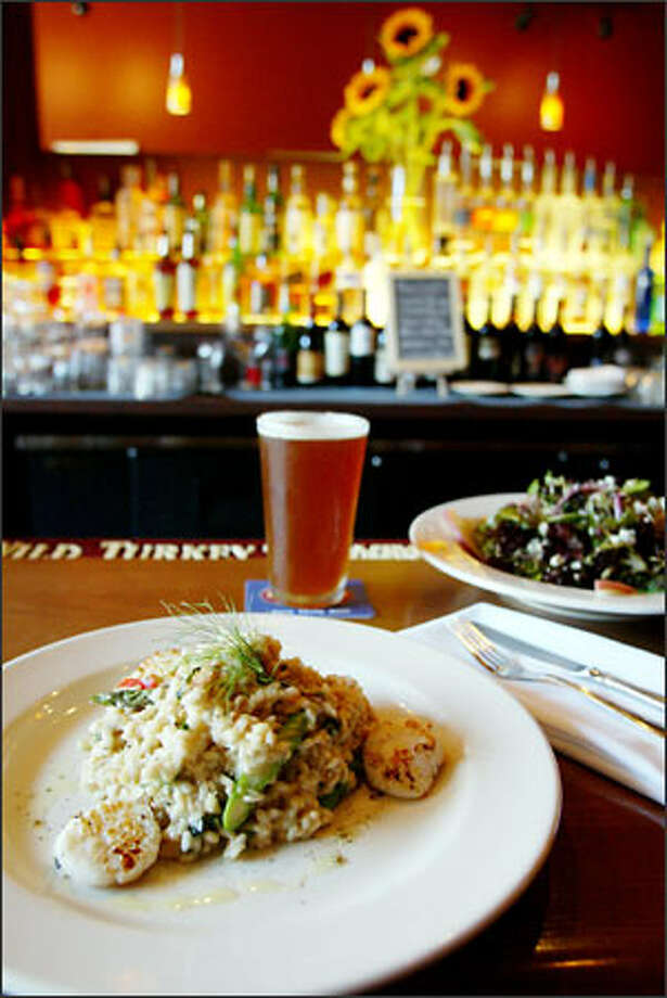 Dungeness crab and scallop risotto with a house salad is one fine choice at Collins Pub, 526 Second Ave., in the Smith Tower. Photo: Paul Joseph Brown/Seattle Post-Intelligencer