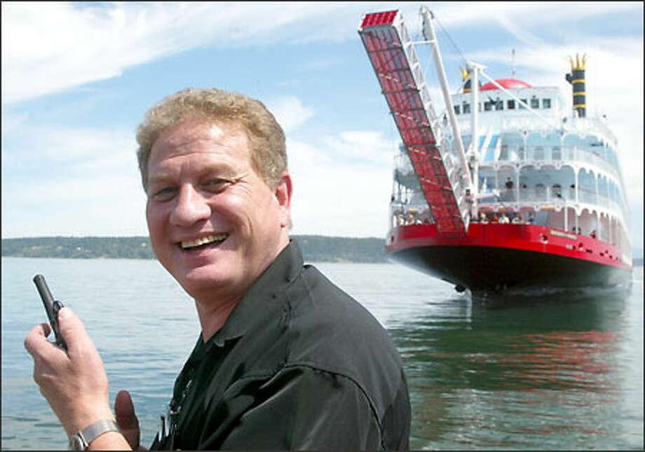 Matt Nichols, chairman of Nichols Bros. Boat Builders, prepares to christen the stern-wheeler cruise ship Empress of the North last month. Photo: Phil H. Webber/Seattle Post-Intelligencer