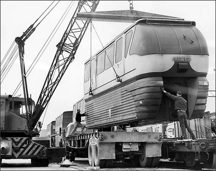 The second Monorail car arrived in 1962 and was unloaded at Terry Avenue and Republican Street. Some damage occurred in the shipping. Photo: / P-I File