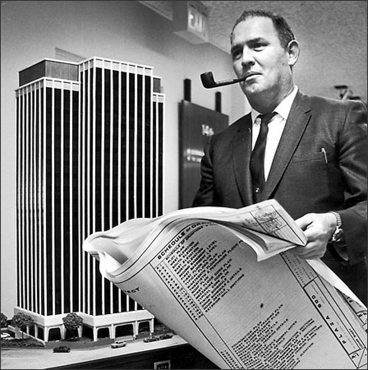 Chester Lindsey stands by a model of the Plaza 600 building in the 1960s.