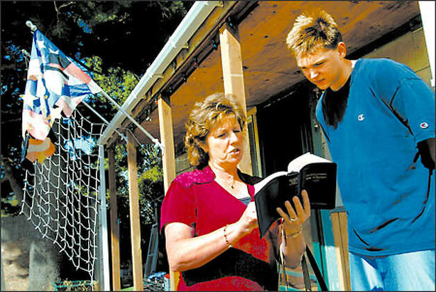 Helen Schwerdtfeger, left, a longtime Jehovah's Witness, shares some Scripture with Tyler Moore, 17, of Renton. Photo: Scott Eklund/Seattle Post-Intelligencer