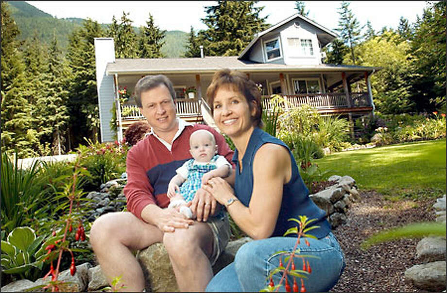 Kurt and Kathy Julian, shown with their 5-month-old adopted son, Alex, are victims of a hoax by a woman who pretended to give up twins for adoption. The North Bend couple traveled to Nebraska at the woman's request. Photo: NINA GREIPEL/THE OREGONIAN