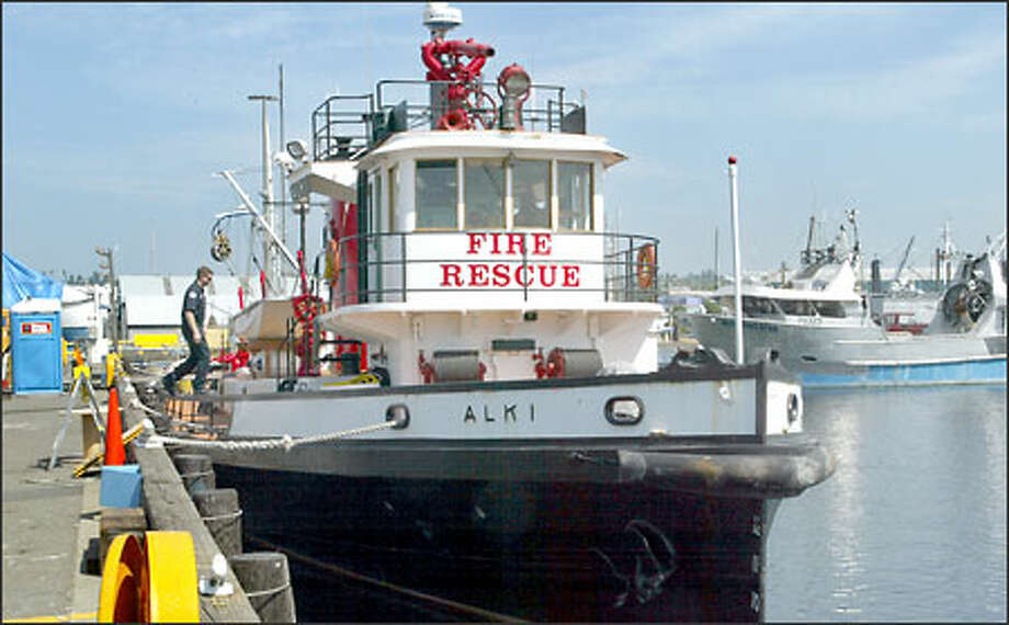The Seattle Fire Department fireboat Alki sits next to a dock at Fishermen's Terminal. The old fireboat is in poor condition, needing almost daily repairs. Photo: Gilbert W. Arias/Seattle Post-Intelligencer