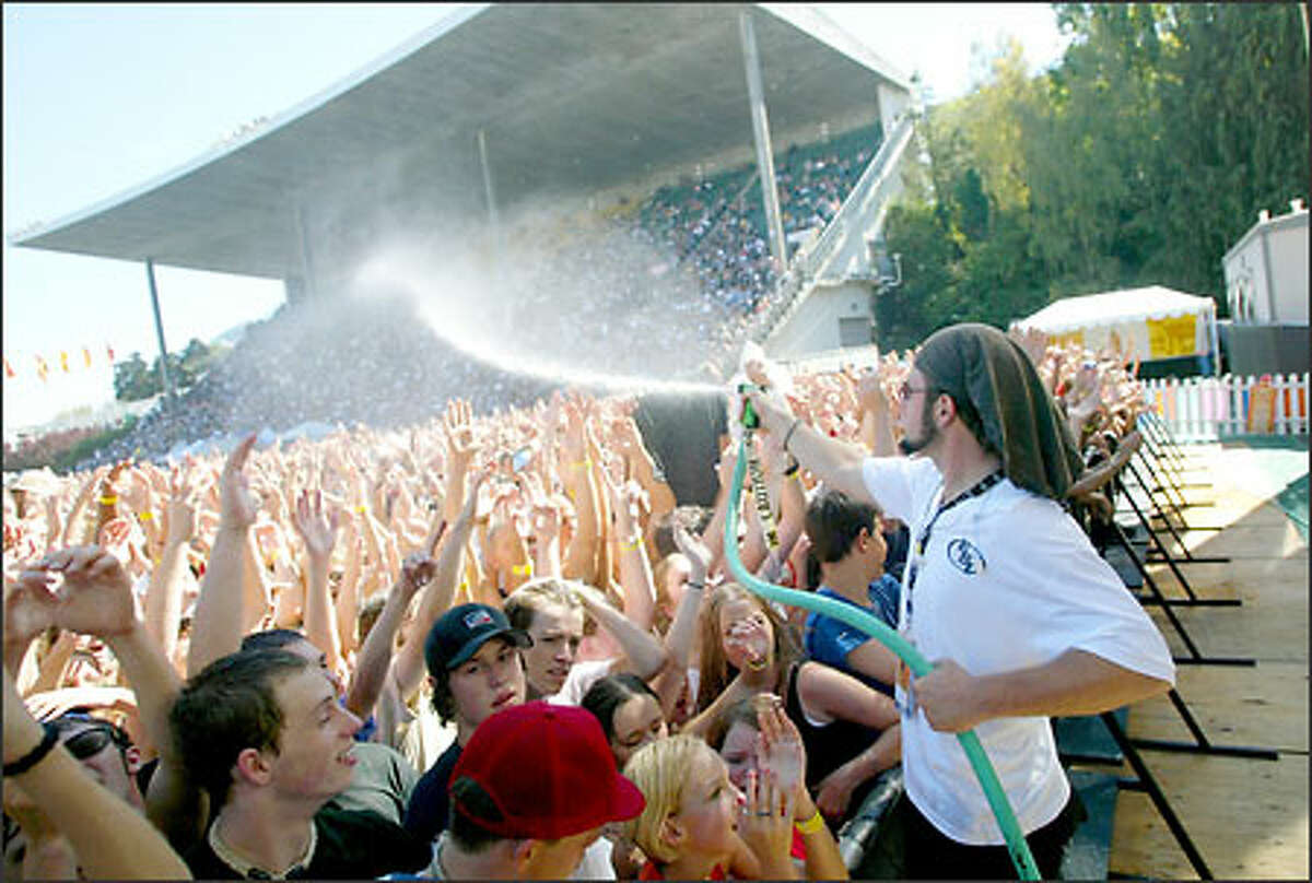 On another sunny and warm day at Bumbershoot yesterday, music fans are cooled down at the Comcast Mainstage between acts.
