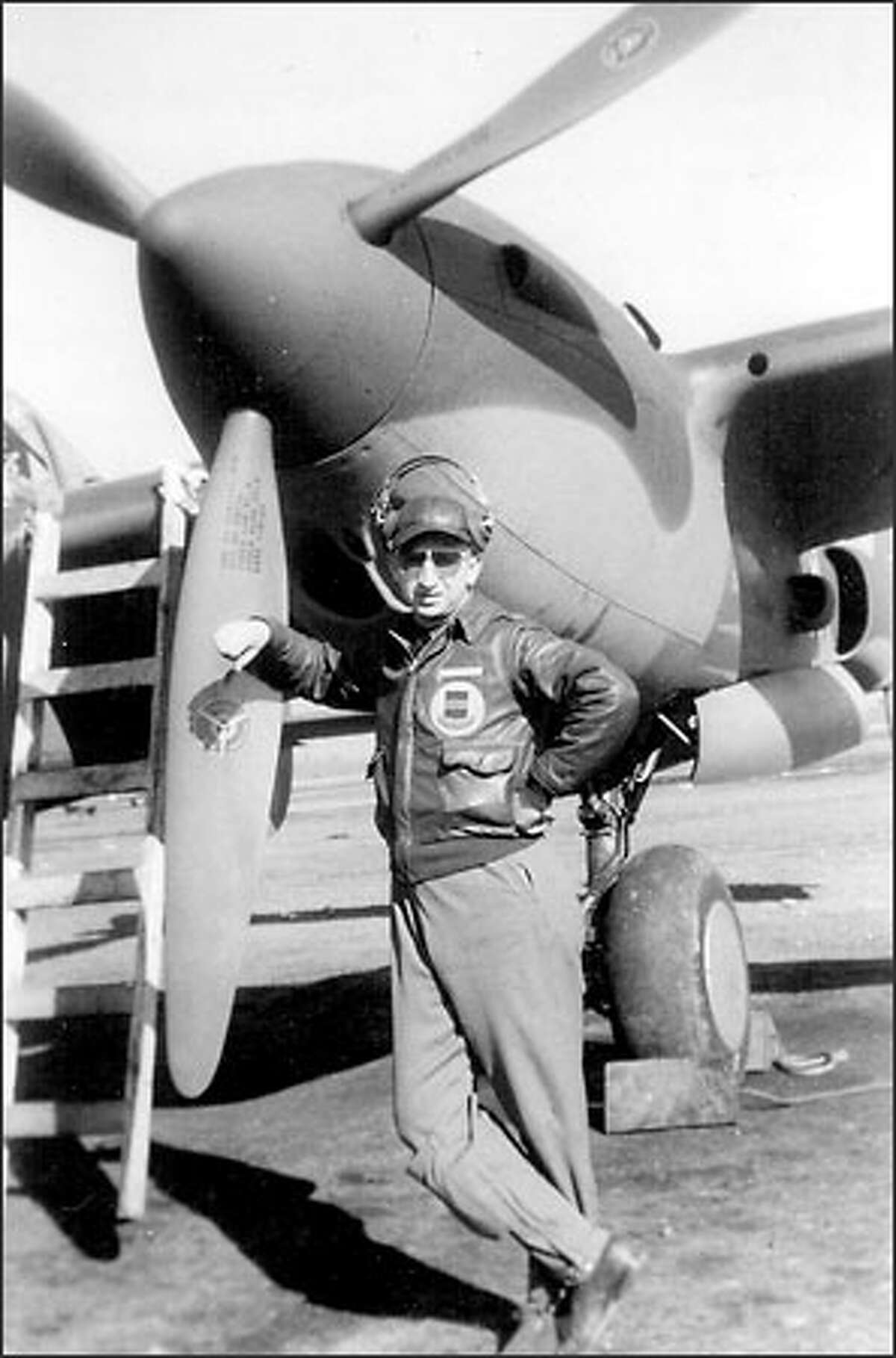 Kenneth Ambrose poses beside a P-38 fighter like the one in which he vanished Nov. 28, 1942.