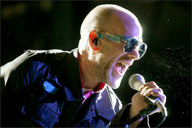 R.E.M. lead singer Michael Stipe performs in Memorial Stadium to close out four days of Bumbershoot. By early yesterday afternoon, wristbands to get into the evening performance -- which included Wilco -- were all scooped up. Photo: Mike Urban/Seattle Post-Intelligencer