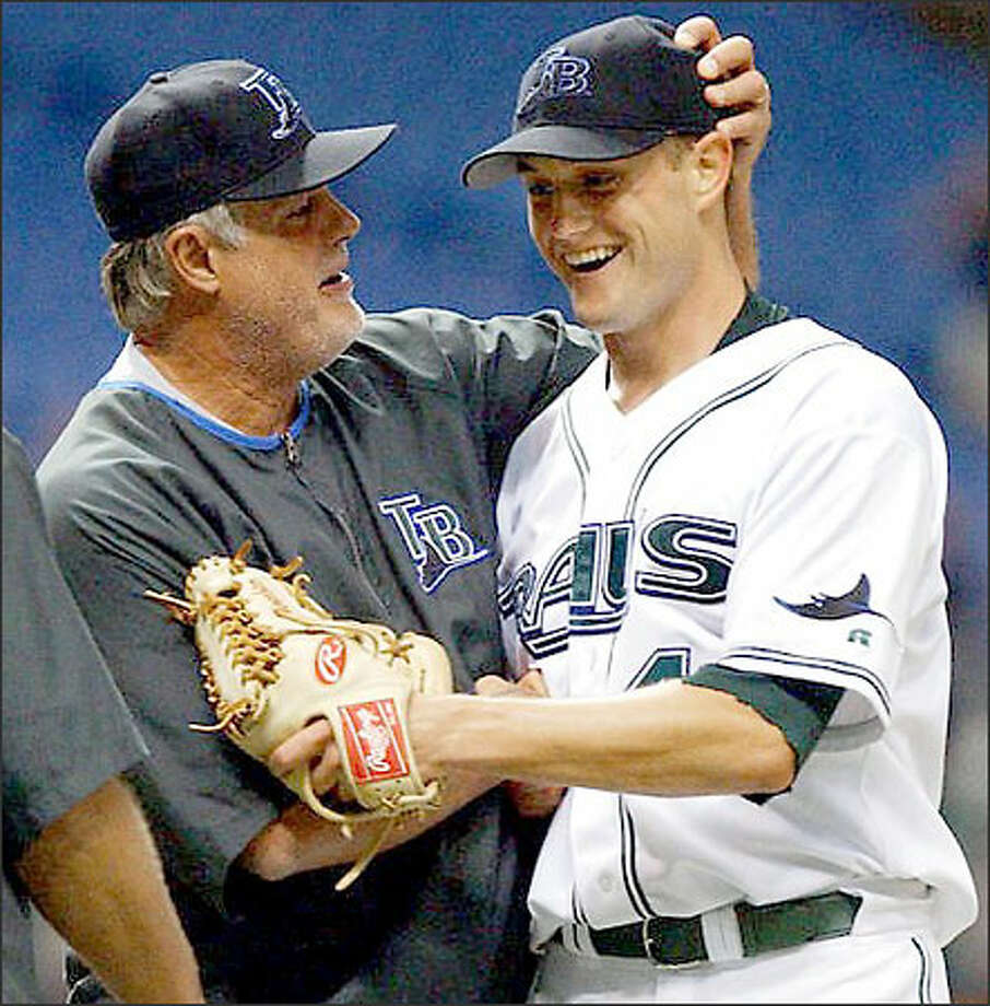 Devil Rays manager Lou Piniella congratulates Doug Waechter on his two-hit, complete-game 7-0 victory. Waechter has two major-league wins -- both against the Mariners. Photo: STEVE NESIUS/AP
