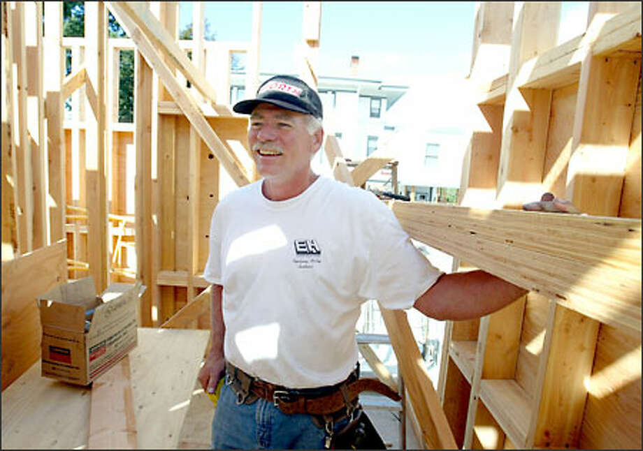 Dan Spillner helps build a house on Queen Anne. Spillner's career was cut short by collusion among owners. Photo: Scott Eklund/Seattle Post-Intelligencer