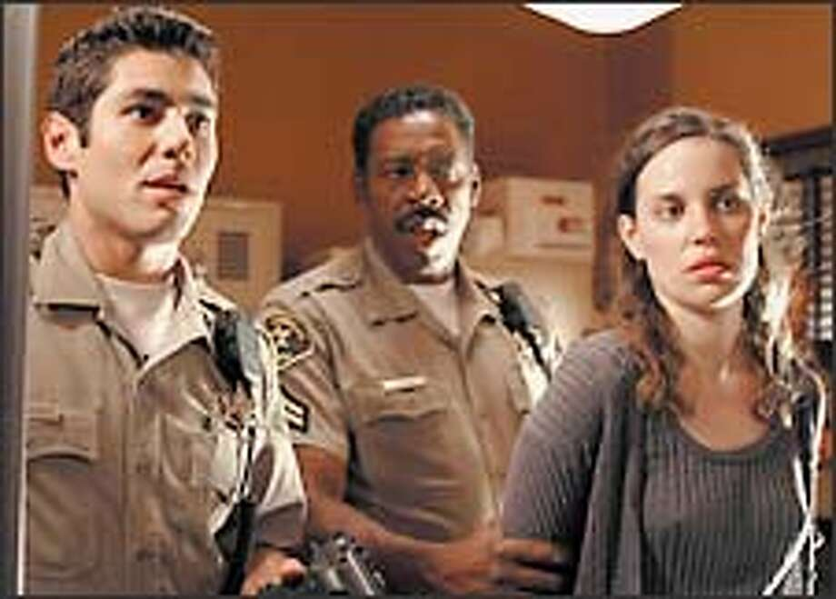 """Danny Nucci, left, and Ernie Hudson help make """"10-8's"""" mixture of action, drama and black comedy feel fresh. (With them is Savannah Haske.) Photo: CARIN BAER/ABC / ABC, INC."""