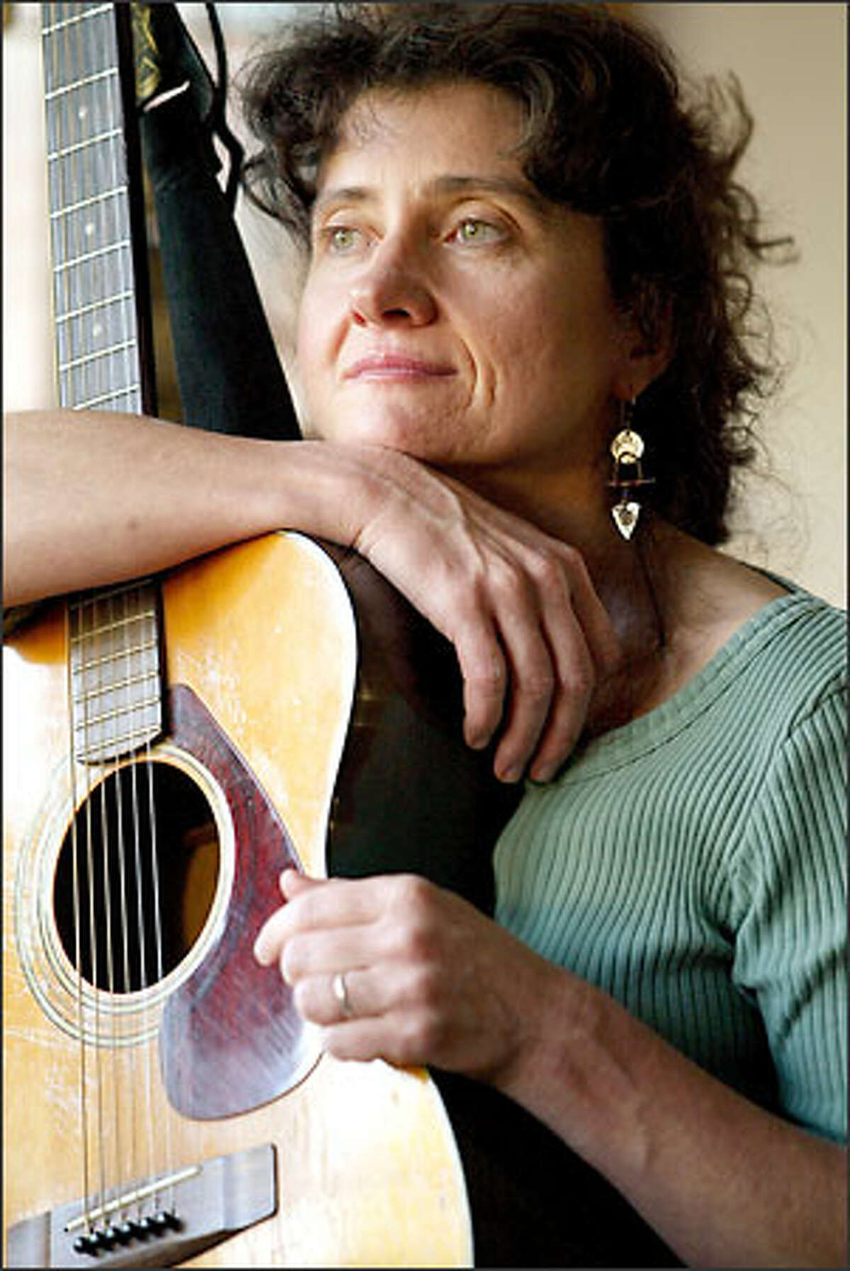 """Music teacher Mary McNeill at her home in Ravenna. """"If you look at issues of peace, inevitably aren't you looking at conflict?"""" she says."""
