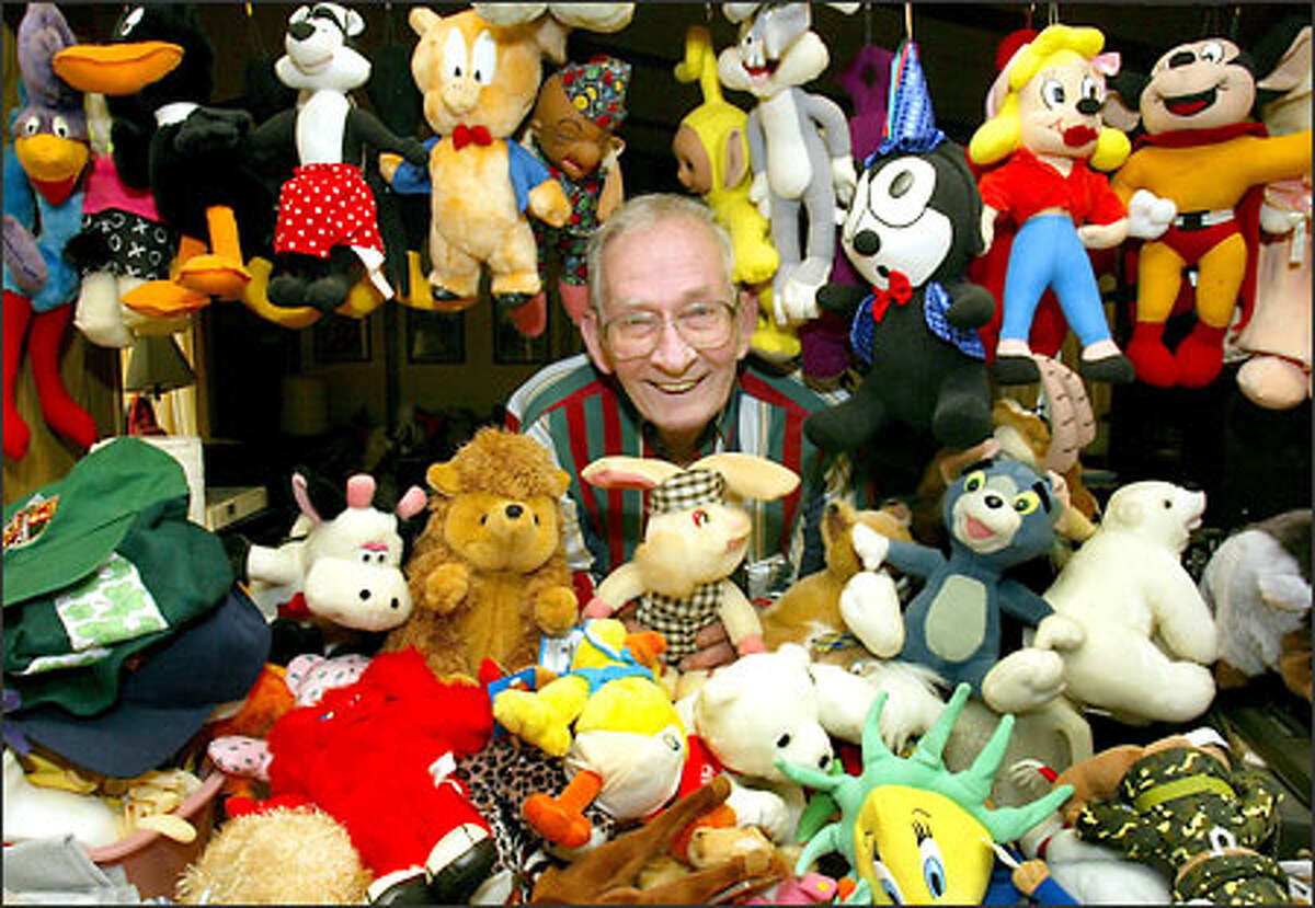 Ronald McInnes, holding the first stuffed bunny he received from a friend, is surrounded by a small portion of his 2,000 stuffed animals he wins in skill crane game machines.