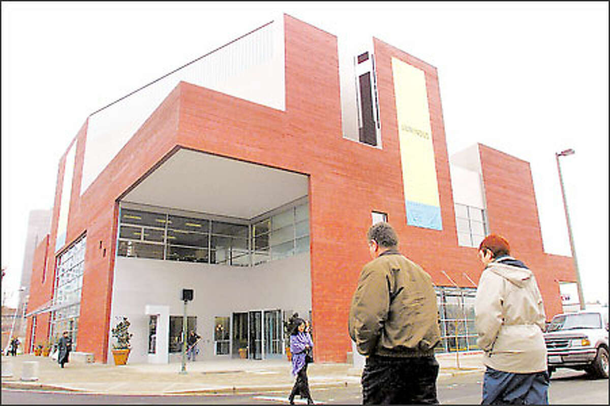 Pedestrians walk past the relocated Bellevue Art Museum in 2001 just before it opened in its new home.