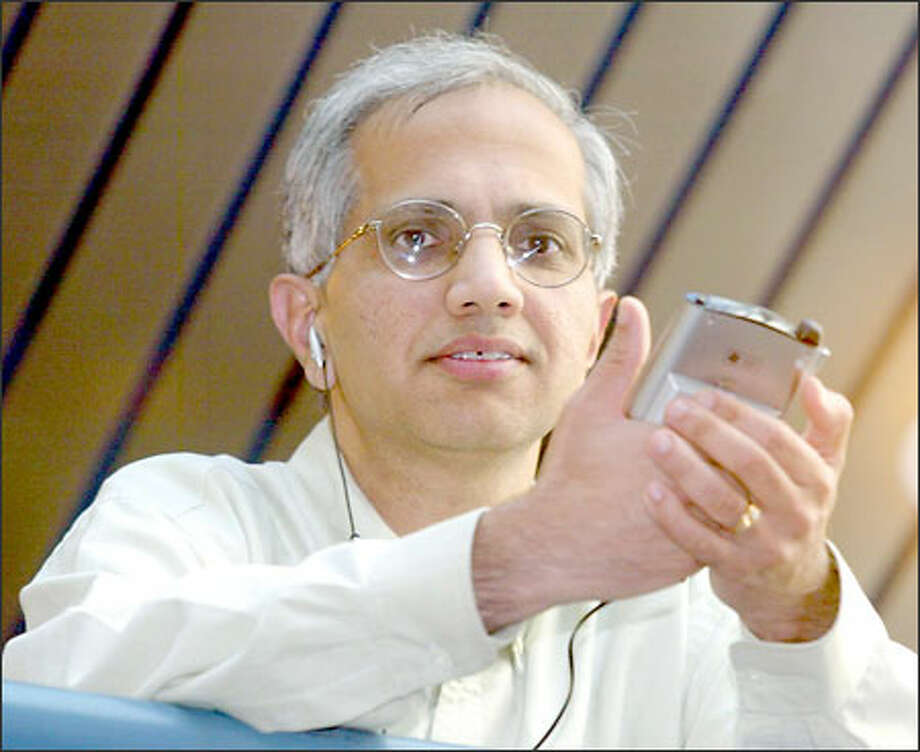 Raju Gulabani believes SymPhone software will transform the way phone calls are made. Investors are adding about $12 million in new capital to his company. Photo: Phil H. Webber/Seattle Post-Intelligencer