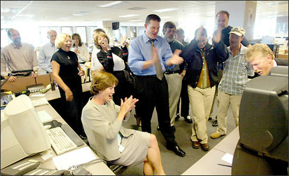 Cheers and clapping break out in the Seattle Post-Intelligencer newsroom as employees learn of yesterday's ruling by King County Superior Court Judge Greg Canova in the battle to keep their newspaper alive. Photo: Karen Ducey/Seattle Post-Intelligencer
