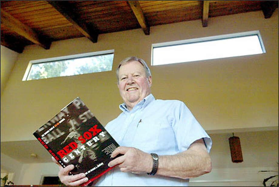 """Harry Frazee III holds a copy of """"Red Sox Century,"""" a chronicle of the Boston Red Sox. His grandfather, Harry Frazee, was the owner of the Red Sox when the team sold Babe Ruth to the New York Yankees. Photo: Scott Eklund/Seattle Post-Intelligencer"""
