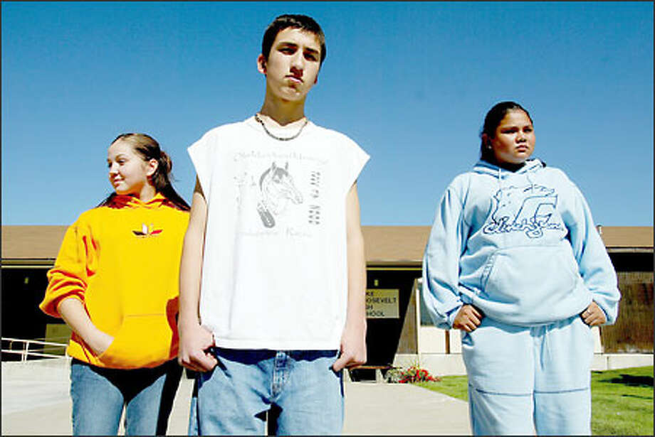 """We're proud to be Native,"" Joel DeWinkler said, explaining the popularity of Native Pride clothes. Jordan DeWinkler, left, and Karyce Palmer stand behind him. Photo: Paul Joseph Brown/Seattle Post-Intelligencer"