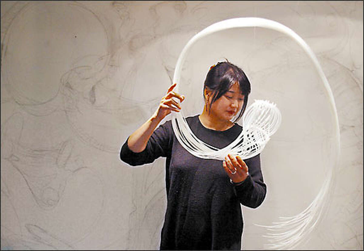 Etsuko Ichikawa uses plastic piping for an installation in her Columbia City home, which will be on the Art Detour Seattle tour. She originally is from Tokyo.