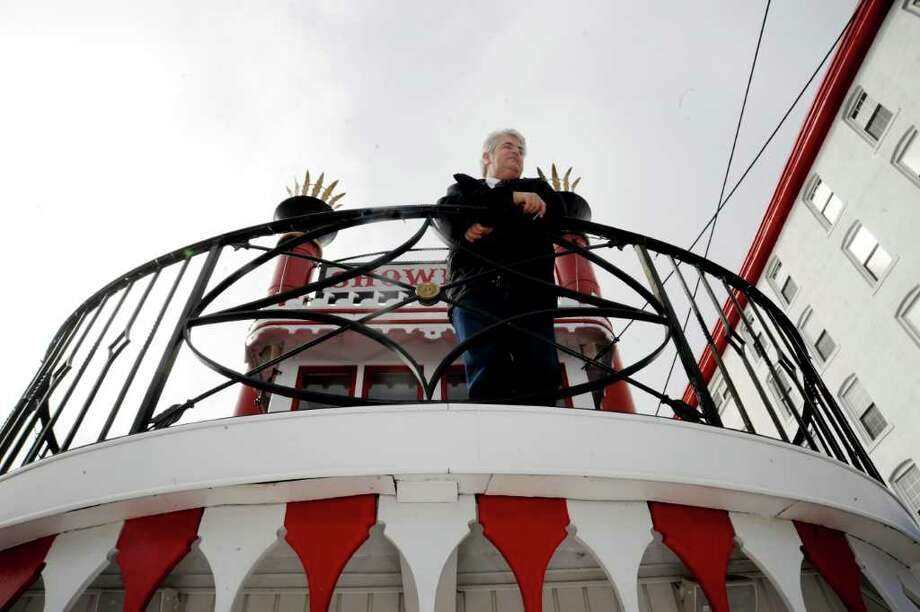 Billy Frenz, of Glenville, stands on the upper deck of his Showboat, which is moored in the Byram River at Port Chester, N.Y., on Wednesday, March 9, 2011. Frenz hopes to move his showboat to Mamaroneck, N.Y., where it will serve as a jazz bar on that town's waterfront. Photo: Helen Neafsey / Greenwich Time