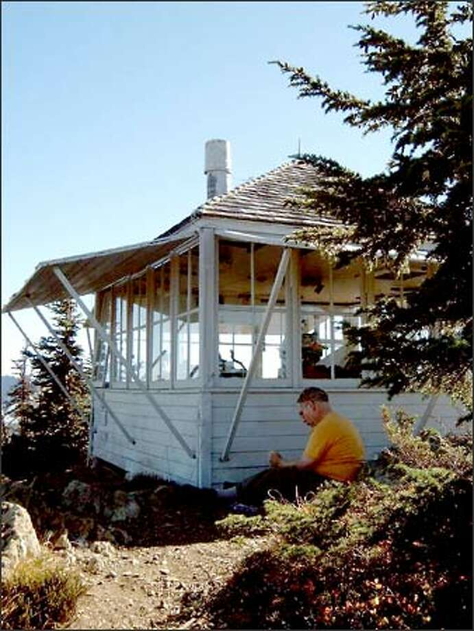 Built in 1933 and now maintained by the Mount Baker Hiking Club, the Winchester Mountain lookout offers commanding views of the North Cascades -- and a shady place to rest. Photo: Karen Sykes/Special To The Post-Intelligencer