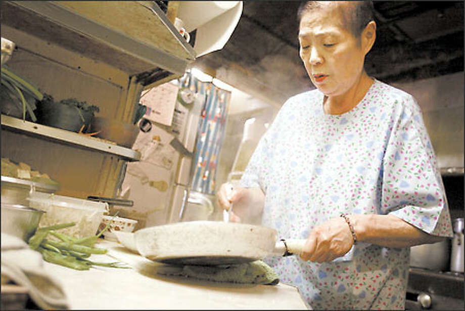 Facing the closure of her restaurant, Sachiko Saito, as always, is concerned about others: her customers who count on her. Photo: Joshua Trujillo/Seattle Post-Intelligencer