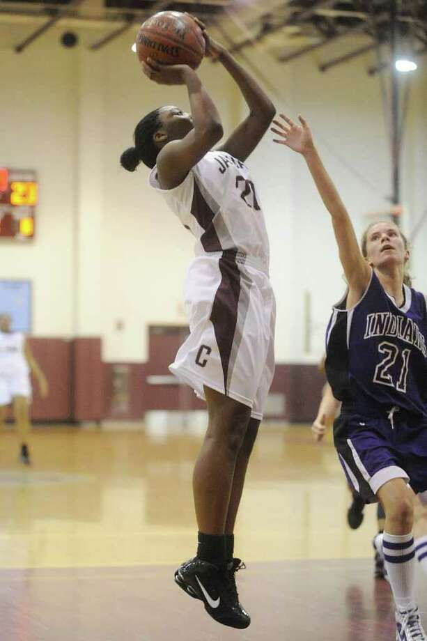 Central's Jalesha Thomas takes a jump shot over PNG Lady Indian Lauren Hanratty in the second half of their game at Central on Tuesday. The Lady Jaguars went on to win the game 80-33. December 15, 2009. Valentino Mauricio/The Enterprise Photo: Valentino Mauricio / Beaumont