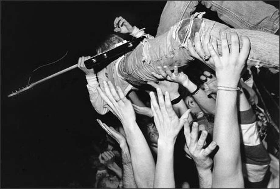 Kurt Cobain and fans at a Nirvana concert in Vancouver, B.C., in 1991. Photo: Charles Peterson, P-I File