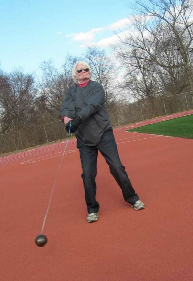 Westporter Ann Marie Flynn, who competed in the 1956 Olympics as a high jumper, recently got involved in hammer throwing. In this photo she demonstrates the wind-up before release. Photo: File Photo / Westport News