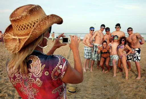 "Amy Ware, from Austin, photographs spring breakers Sunday March 13, 2011 during ""Texas Week""  on South Padre Island. Photo: EDWARD A. ORNELAS, Express-News / SAN ANTONIO EXPRESS-NEWS NFS"